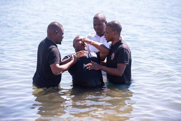 Shepherd Bushiri, right, baptising one of his South African followers in Lake Malawi.