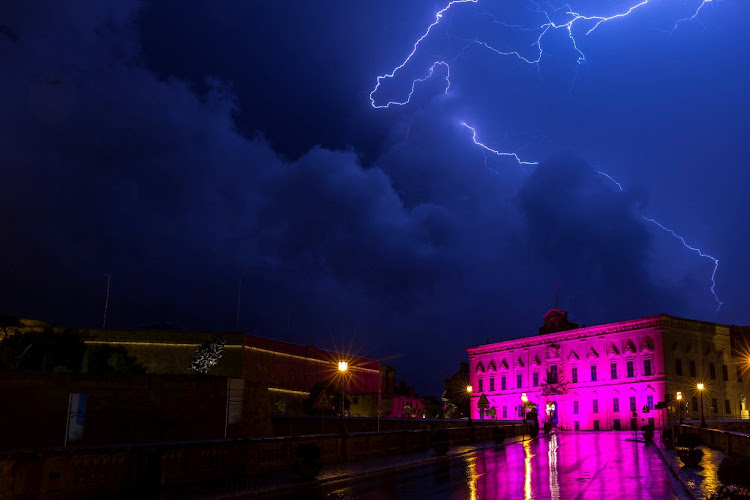 Lightning streaks over the Auberge de Castille, the office of Malta PM Joseph Muscat.