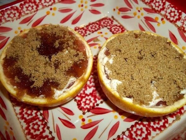 Spread 1 tablespoon brown sugar over each halve.