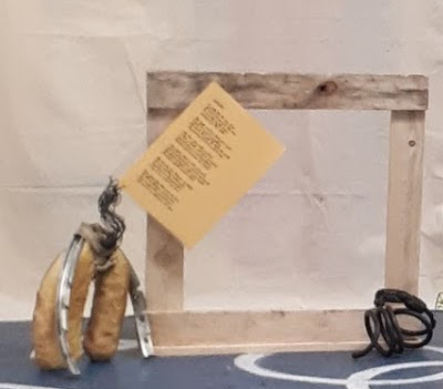 Autophilia installation with the genitalia sculpture alongside a bicycle rack and cut bicycle lock