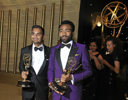 Aziz Ansari, left, and Donald Glover pose with their Emmys. Picture: REUTERS