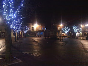 Photo: An empty market place except for a pidgeon and greenfinch trying to start a dawn chorus around the xmas lights.
