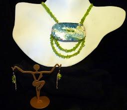 Photo: <BEREHYNYA> {Great Goddess Protectress} unique one-of-a-kind statement jewellery by Luba Bilash ART & ADORNMENT  UNDERCURRENT - ТЕЧІЯ - copper enamel pendant, peridot, rose gold vermeil $170/set SOLD