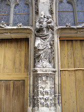 Photo: The age of the church, and the challenges to any restoration, are evidenced by this statue at the main doors.