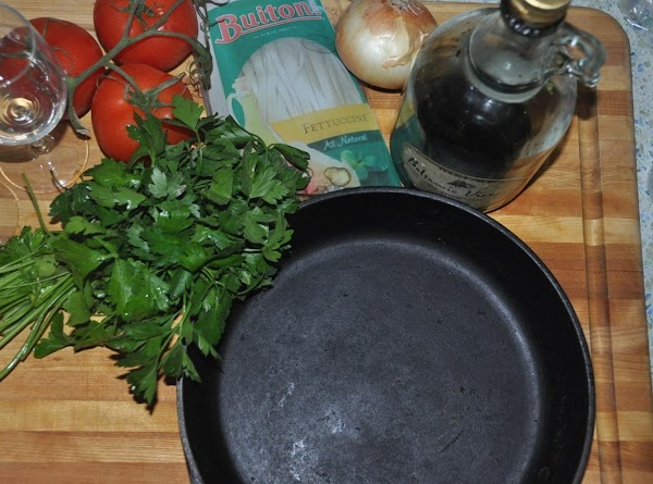 Wash the tomato and the lime.Turn a cast-iron skillet on medium heat, add some...