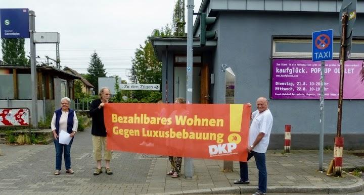 Demonstrierende mit Transparent: DKP fordert «Bezahlbares Wohnen! Gegem Luxusbebauung!».