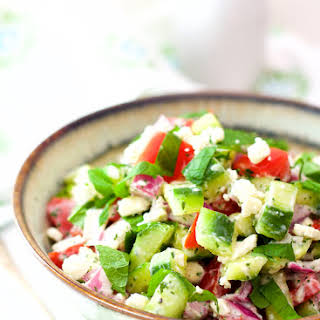 Cucumber, Tomato and Red Onion Salad with Yogurt - Mint Dressing and Feta Cheese.