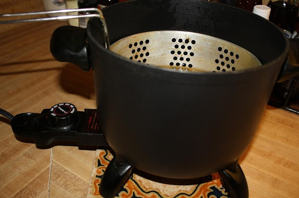 Heat oil.  I use a Fry Daddy (with a basket) that is set...
