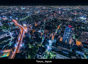 Photo: A sea of lights and concrete span into the night sky in Tokyo, Japan