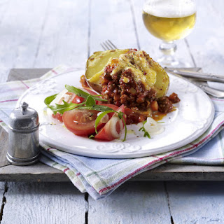 Baked Potatoes with Bolognese Sauce and Arugula and Tomato Salad