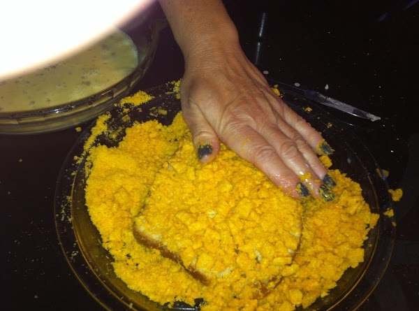 DIP BREAD INTO EGG MIXTURE (DO NOT SATURATE)....THEN PRESS INTO CRUSHD CEREAL.