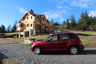Photo: Rental Car. Roof dried in (metal roofing comes very last, after all necessary roof walking is completed).