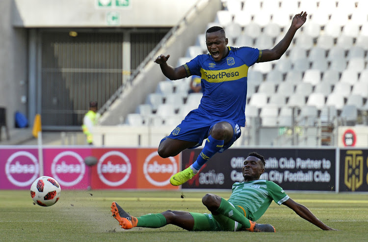 Ayanda Patosi of Cape Town City FC tackled by Lucky Baloyi of Bloemfontein Celtic during the Absa Premiership match at Cape Town Stadium in Cape Town on Saturday December 22 2018.