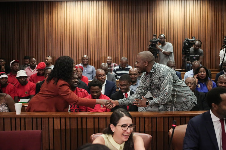 Leader of the DA Mmusi Maimane (Left) greets the former Public Protector Adv Thuli Madonsela at the North Gautneg High Court in Pretoria after the court found that President Jacob Zuma be personally liable for the costs into an bid to halt the state capture report.