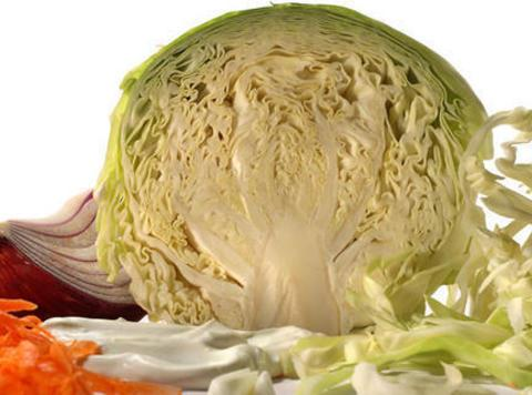 For the coleslaw slice the cabbage in half through the core. Cut in V-...