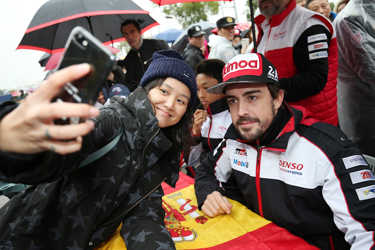 Fernando Alonso of Spain and Toyota Gazoo Racing with fans at the WEC 6 Hours of Shanghai, round 5 of the FIA World Endurance Championship Super Season on November 18, 2018 in Shanghai, China.