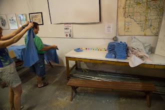 Photo: Tony folding shirts, with Sharon helping