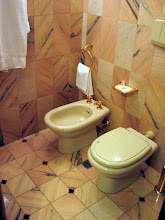 Photo: Pink marble and gold fixtures, what more could you want?