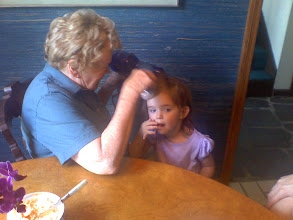 Photo: Mia after her first swim of the summer, getting her hair dried by her great-grandmother.