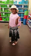 Photo: Kaleya having fun at Dollar Tree - ready for the beach!