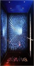 """Photo: GLAVIVA • Digitaldruck auf Glas • www.glaviva.de  Verkleidung eines Aufzugs aus Glas digital bedruckt • Individuelles Glaviva-Glasdesign """"Space Elevator"""" (© Wolfgang Dehmel) für OTIS-Aufzüge 2006 (3D-Simulation Aufzugdesign)"""