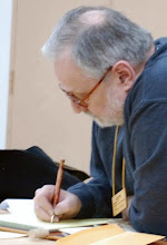 Photo: Newsletter Editor Michael Blake hard at work (with a nicely turned pen).