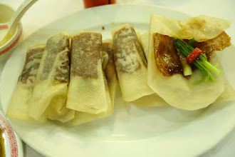 Photo: The skin of the duck is wrapped in a crepe with cucumber, green onion and pepper. Not my favorite.
