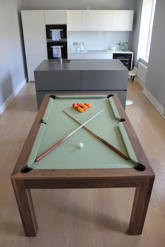 Refined Pool Table in Contemporary Apartment on light wood flooring