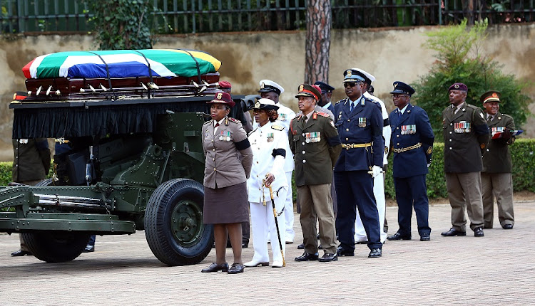 Winnie Madikizela Mandela's body is loaded at the back of a gun carriage as she is taken to her final resting place at Fourways Memorial Park. Picture: MASI LOSI