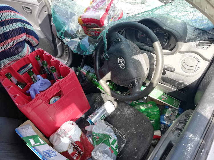 Bottles and cans of alcohol were found in the car after the crash. Luckily, no one was injured although attempted murder is one of the charges the driver faces.