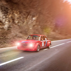 Old BMW by Laurentiu Barbu - Transportation Automobiles ( flare, forest, edit, photoshop art, old, headlights, tree, photoshop, romania, bmw, sun, hillclimb, red, rocks, road, sunset, cinematic, landscape, photography, roadinforest )