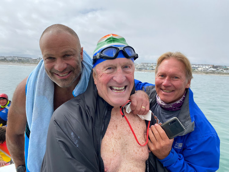 Pacesetter Martin Goodman, left, celebrates with Cape Town heart surgeon Otto Thaning and skipper Roger Finch after the 80-year-old's Robben Island crossing.