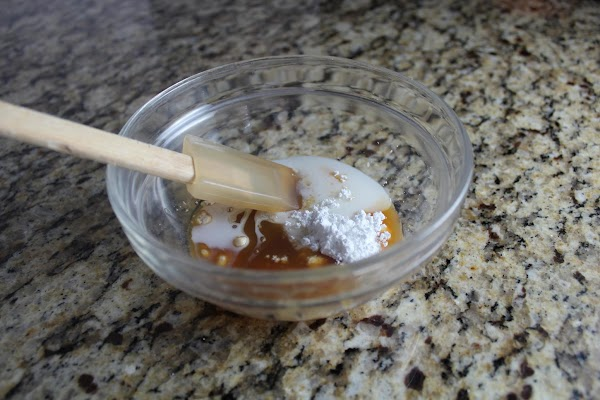 Meanwhile, prepare caramel glaze. In a medium bowl, stir powdered sugar, caramel topping and...