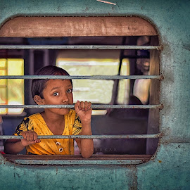 The window girl. by Pranab Sarkar - Babies & Children Children Candids ( child portrait, candid, children, station, window, railway, india )