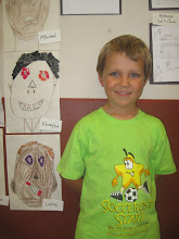 Photo: Lukas in front of his artwork