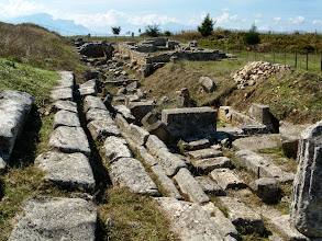 Photo: Byllis, Stadion 3rd century BC, running over the cistern in the background