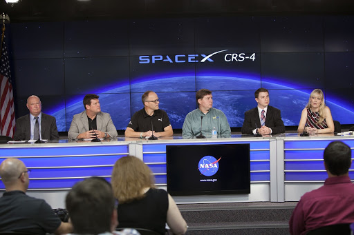 Media representatives ask questions of the ISS Research and Technology Panel in Kennedy Space Center's Press Site auditorium in preparation.