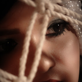 Looking through Hammock by Bihong Kollogov - People Portraits of Women ( close up, face, woman, beauty, lady, looking, portrait, net, eyes, elegant )