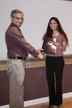 Photo: Gireeja Ranade accepting the Demetri Angelakos Memorial Achievement Award.