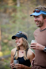 Photo: Couple drinking wine while on a whitewater raft trip on the Chilko River. British Columbia, Canada.