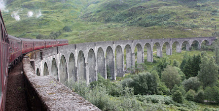 Photo: Jacobite steam train on Glenfinnan viaduct
