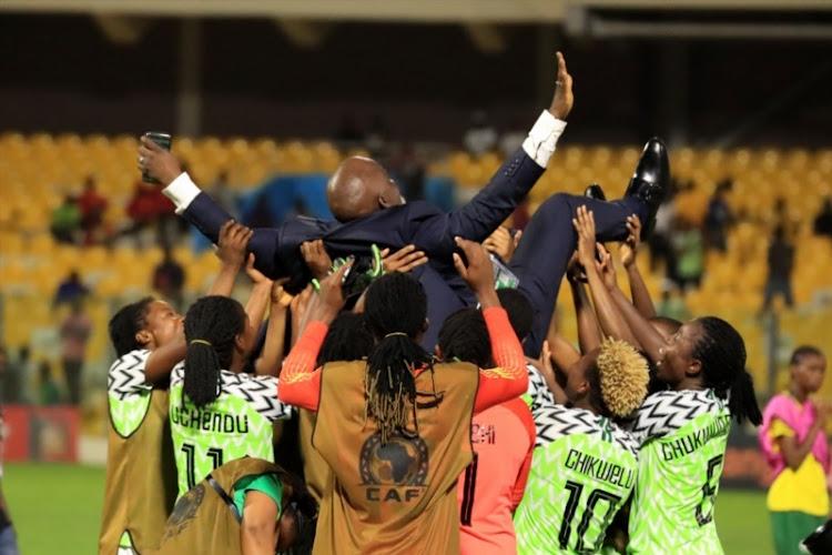 Amaju Pinnick (NFF President) being lifted up by Nigeria players during the 2018 African Womens Cup of Nations match between Nigeria and South Africa in Accra in December 2018.
