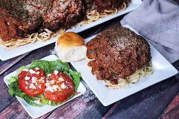 Cube Steak Parmesan Over Spaghetti