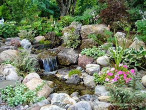 Photo: #Pondless Waterfalls, Disappearing Waterfalls, Vanishing Waterfalls, Child Safe Design, #WaterfallDesign, Contractor in Rochester NY by Acorn Ponds & Waterfalls, Certified Aquascape Contractor since 2004.  Check out our website www.acornponds.com and give us a call 585.442.6373.  Interested in a Waterfalls without the pond? Please click here: www.acornponds.com/pondless-waterfalls.html  Acorn Ponds & Waterfalls of Rochester NY, 585-442-6373, is a Certified Aquascape Contractor, Landscape Designer, Outdoor Lighting Designer, Installer, Builder, Contractor and Design Service Company from Rochester, NY. We have professional Installation and Design Services available for the following: Landscape Design Outdoor Room Design Backyard Ponds and Waterfalls Design & Construction Patios and Walkways: Paver, Stone, Brick Low Voltage Landscape Lighting LED Landscape Lighting Swimming Ponds Ecosystem Ponds LED Outdoor Lighting Retaining Walls Fountains Water Features Pondless Waterfalls Pond Maintenance and Design Aquatic and Under Water LED Lights Bubbling Boulders and Urns Natural Stone Patios and Rock Gardens Garden Ponds Outdoor Kitchens Pizza Ovens Fire Pits Fish or Koi Ponds Waterfall Ponds Low Maintenance Plantings Commercial Landscape Design Residencial Landscape Design Drainage Issues, Solutions Aquascape Rainwater Collection Systems  Servicing: Pittsford NY, Penfield NY, Brighton NY, Fairport NY, Webster NY, Greece NY, Victor NY, Henrietta NY, Irondequoit NY, Rush NY.  For more info about Acorn Ponds & Waterfalls Services, please click here: www.acornponds.com/services.html  Check out our photo albums on Pinterest here: www.pinterest.com/acornlandscape/  Click here for a free Magazine all about Ponds and Water Features: http://flip.it/gsrNN  Sign up for your personal design consultation here: www.acornponds.com/contact-us.html  Acorn Ponds & Waterfalls  585.442.6373 www.acornponds.com