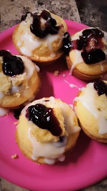 Ultimate stuffed Blueberry muffins w/ a glaze.