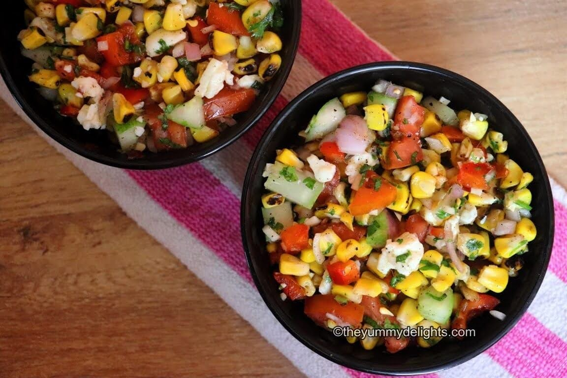 grilled corn salad in black bowl. A close-up image of two corn salad bowl placed next to each other.