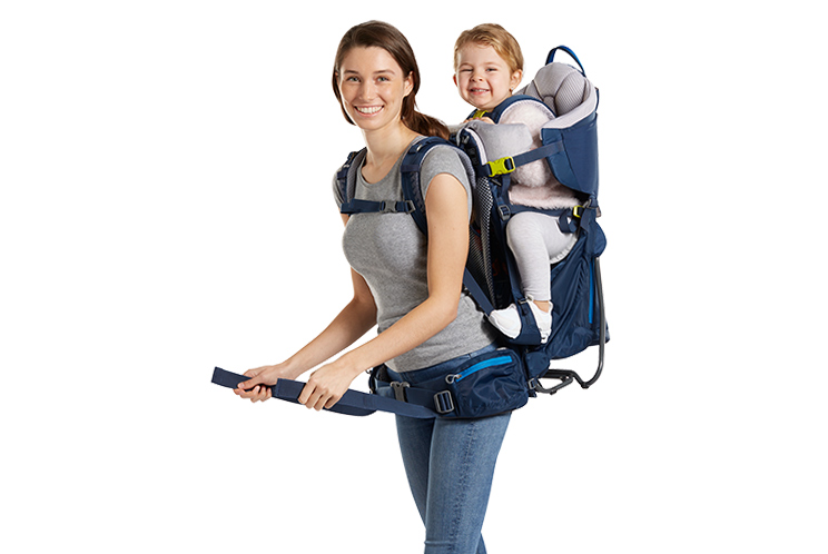 woman carrying a child in a Deuter Kid Comfort pack
