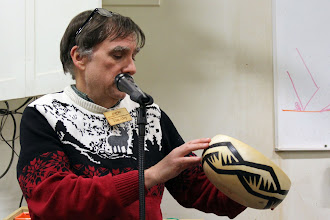 Photo: Program Chair Tim Aley discusses his burning and painting of a modified Native American pattern.