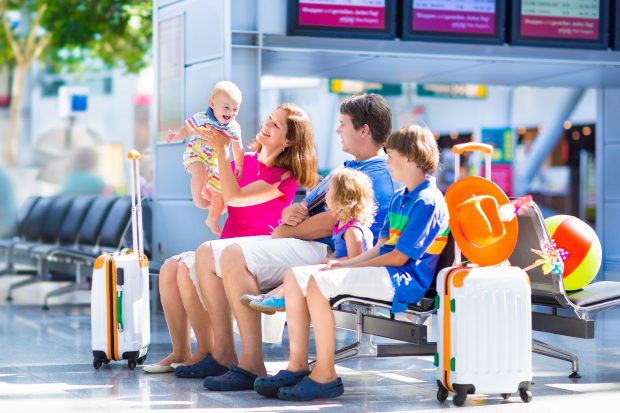 Image of a family in an airport - shows that schoolteacher making a million dollars has time to enjoy quality time with the family