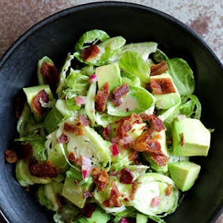 Shredded Raw Brussels Sprout Salad with Bacon and Avocado.